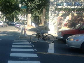 this bicyclist rode through a stop sign, past a right-turning car, rude and dangerous