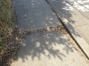 broken sidewalk, Sutterville Road at 24th Street